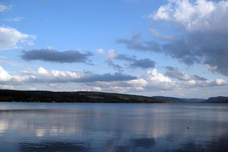 A photo of Otisco Lake on a blue skied day