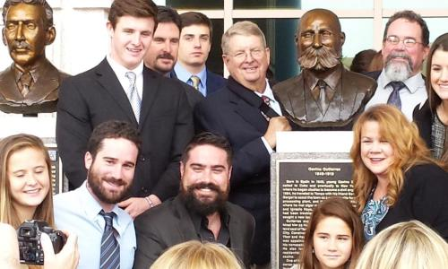 Descendants of Ybor City architect Gavino Gutierrez gather around his bust, one of six new additions to the Tampa Riverwalk Historic Monument Trail.