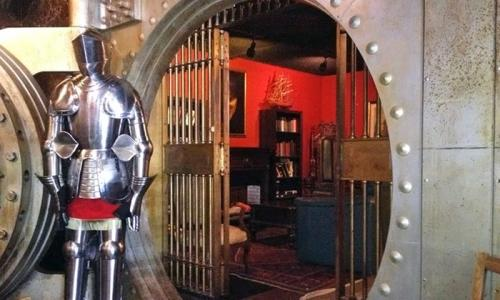 A photo looking in to a a medieval looking escape room