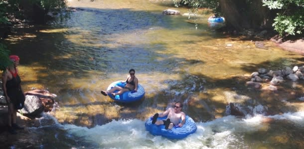 People tubing Boulder Creek