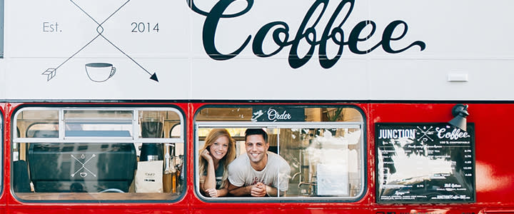 Owners Of Junction Coffee In The Window Of The Double-Decker Bus In OKC