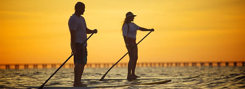 Couple Paddle Boarding in Virginia Beach