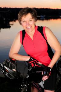 Valerie Knoblauch poses for a photo in front of a lake
