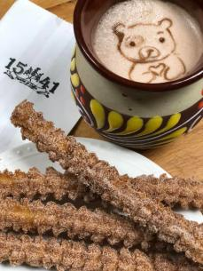 1541 Churros and Italian Coffee with a bear design in the foam
