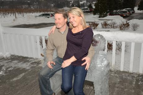 Couple sits on an ice bench at the NYS Ice Wine Festival
