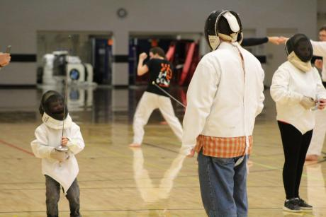 Little boy takes on father at fencing at Imagine RIT