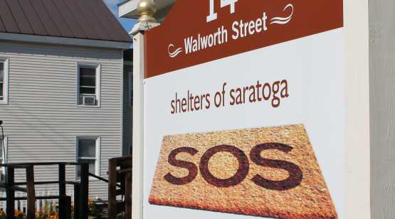 Shelters of Saratoga outside street sign