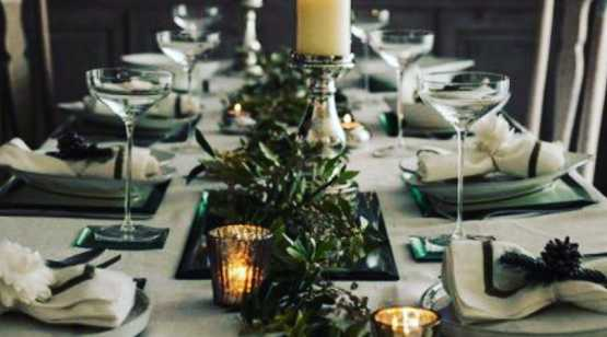 Karen & Co place settings with candles and greens down center