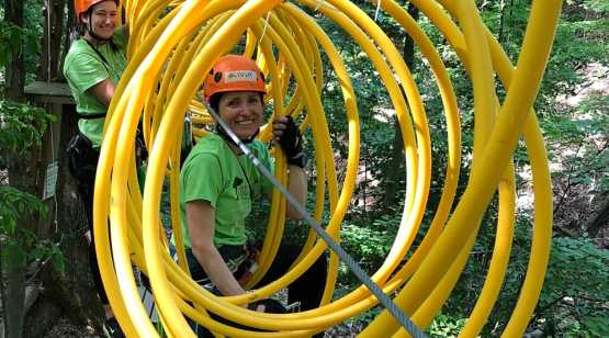 Mountain Ridge Adventure woman in coil obstacle