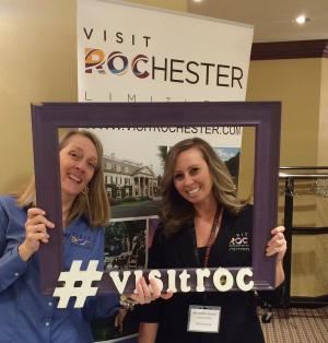 Visit Rochester Staff show off their Rochester pride at the Roc to Albany Tradeshow event