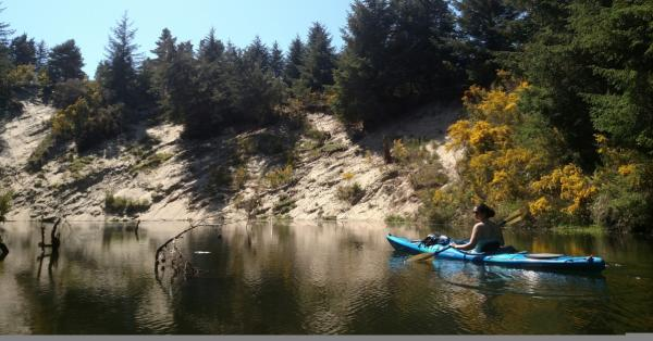 Kayaking on the Siltcoos River Trail by Wyatt Pace