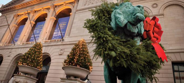 Art Institute Lion statute wearing a Christmas wreath in Chicago