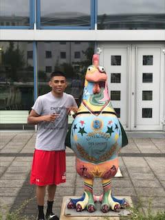 Angel Martinez and chicken statue