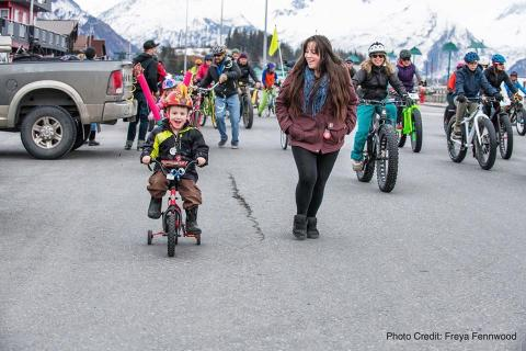 children ride bicycles through Valdez, Alaska
