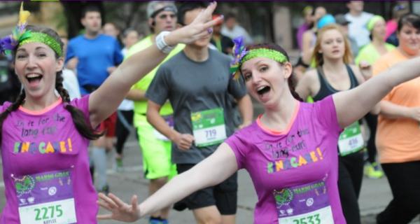 Runners are having a fun time at the Mardi Gras Mambo 5k in Baton Rouge, LA.