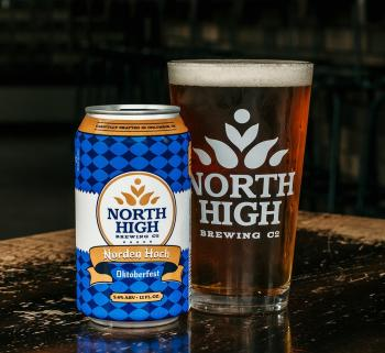 Can and pint glass of Oktoberfest beer from North High Brewing