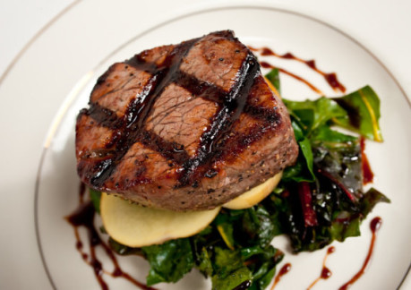 85PPGrilled Filet mignon with port-balsamic beurre rouge over bacon seared greens with potatoes.jpg