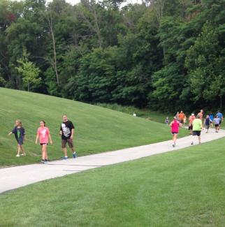 Runners/walkers enjoying the views at Avon Town Hall Park.