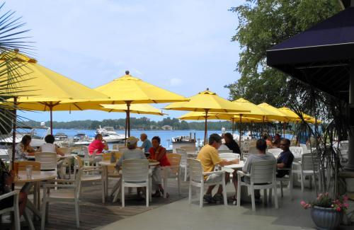 Yellow Umbrellas, Lakeside, Patio, White chairs