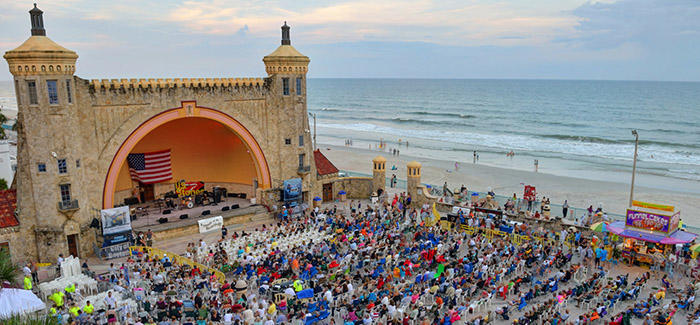 A view of a Bandshell summer concert before the sun sets.