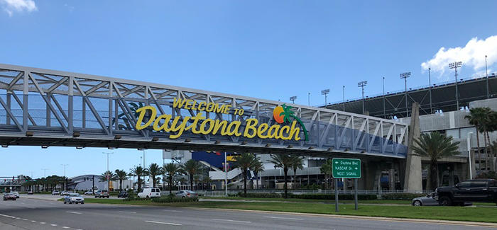 The Welcome To Daytona Beach Sign is also a pedestrian bridge to Daytona International Speedway.