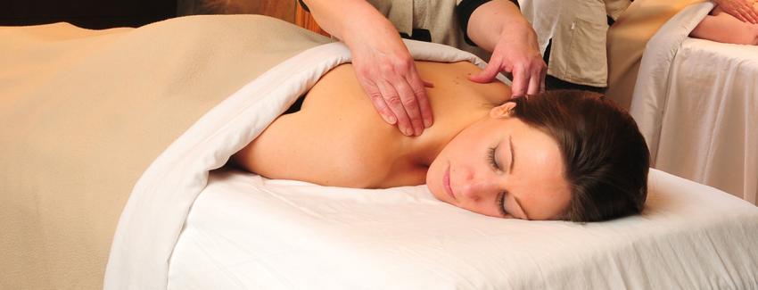 A woman gets a massage at Isabella Spa at Belhurst Castle
