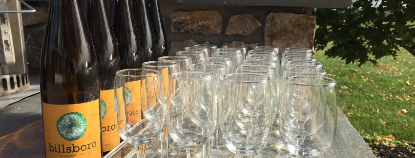 Wine bottles sit near empty glasses at Bilsboro Winery in Geneva