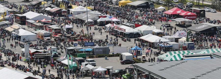 The midway at Daytona International Speedway is teeming with vendors and crowds