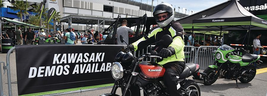 A rider anticipates demo riding a Kawasaki motorcycle during Bike Week at Daytona International Speedway