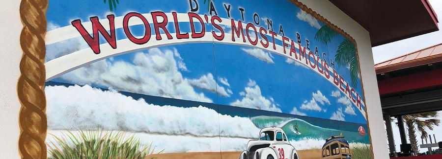 Crabby's Oceanside Mural depicts the World's Most Famous Beach sign with the #39 beach racing car on the beach.