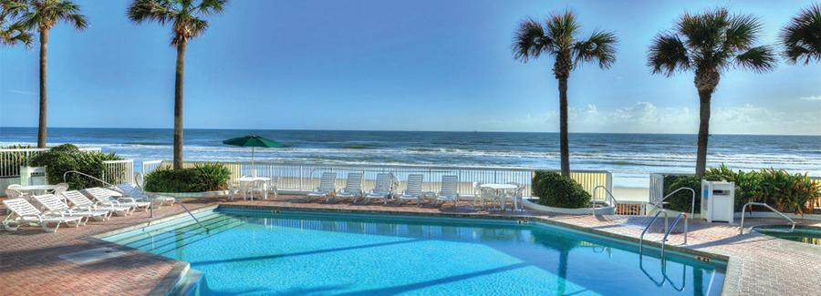 An inviting pool is a serene scene at a Daytona Beach oceanfront hotel