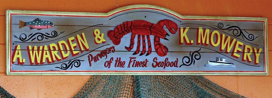 A retro sign indicates purveyors of the finest seafood at Our Deck Down Under