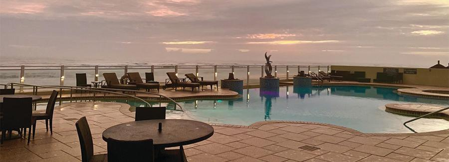 A beautiful sunrise greets you from the pool deck of the Residence Inn by Marriott Daytona Beach Oceanfront