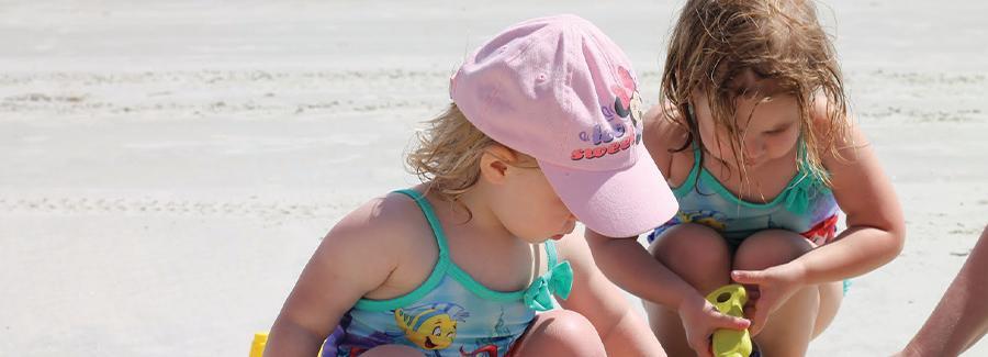 Toddlers enjoy making sand castles and shelling on Daytona Beach