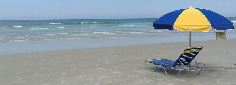 Rent an umbrella chair for a day and relax on Daytona Beach