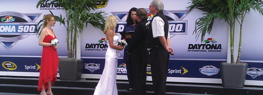 A couple gets married at Daytona International Speedway's Victory Lane