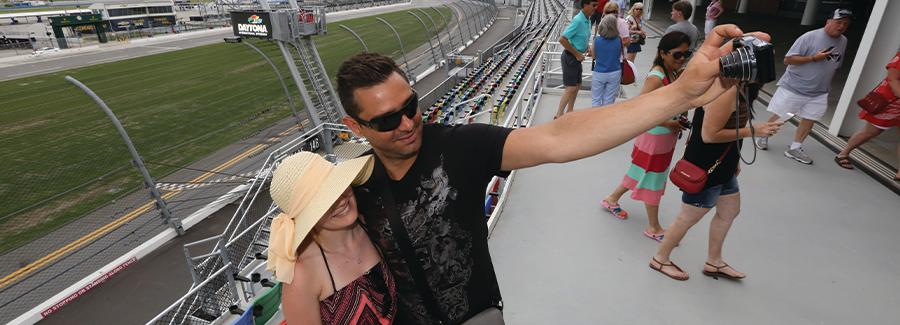 A couple takes a selfie at Daytona International Speedway