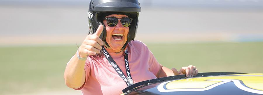 A woman gives the thumbs up for the NASCAR Racing Experience