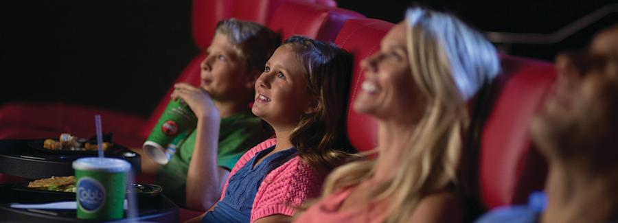Watching a movie at ONE DAYTONA's Cobb Theatre is a fun and relaxing family experience