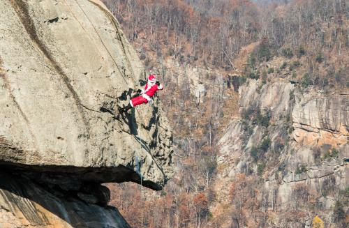 Santa rappels down Chimney Rock near Asheville, NC
