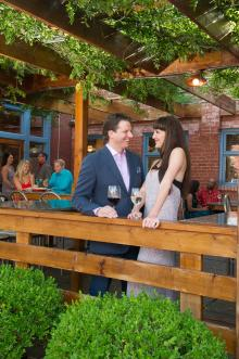 A man and woman enjoy wine on a date at Larkspur in Wichita