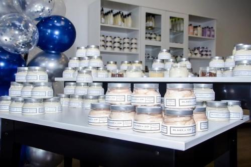 A display of Blake N Co skincare products line a shop counter top.