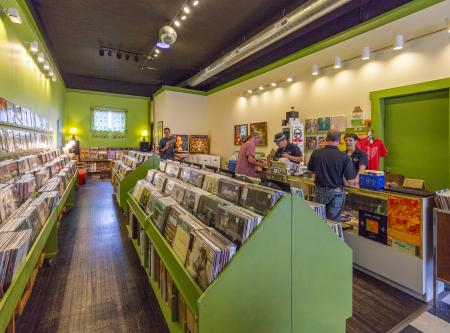 View of vibrant interiors and aisles, shoppers at Spoonful Records