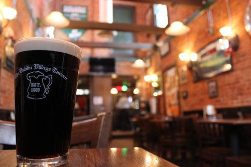 A pint of Guinness inside the Dublin Village Tavern.