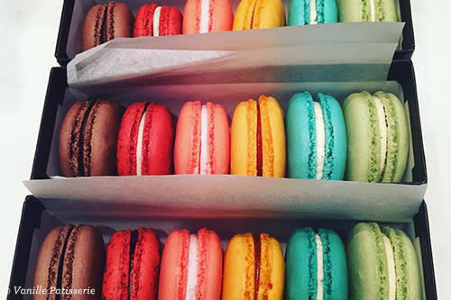 Boxes of multicolored macarons