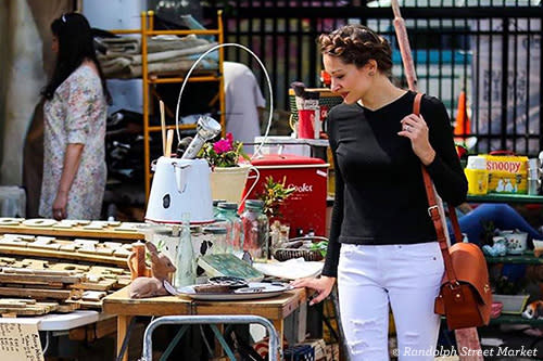 Randolph Street Market shopper perusing goods at a stall