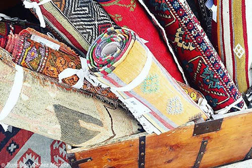 Crate filled with antique rugs