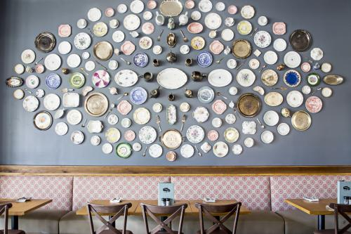 Tupelo Honey Button Wall Covered In Plates