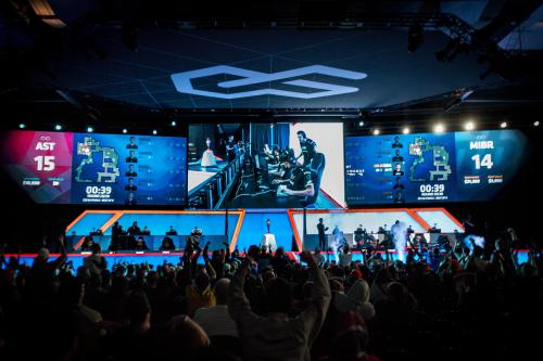 Esports Stadium Arlington main stage wide shot with players and cheering crowd