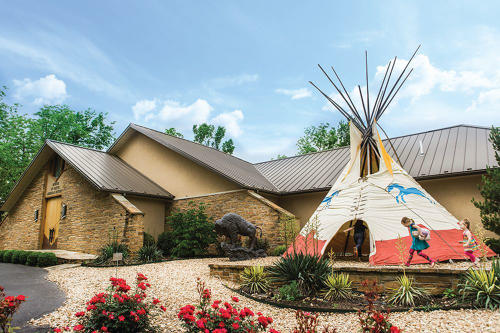 Exterior image of the Museum of Native American History. The focal point is on the giant TP in the front lawn